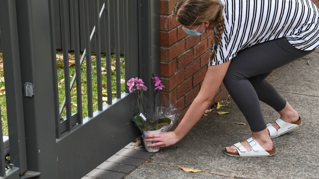 Passionate supporters of Premier Gladys Berejiklian have left balloons and flowers outside her Sydney residence as they mourn her resignation. Picture: James D. Morgan/Getty Images