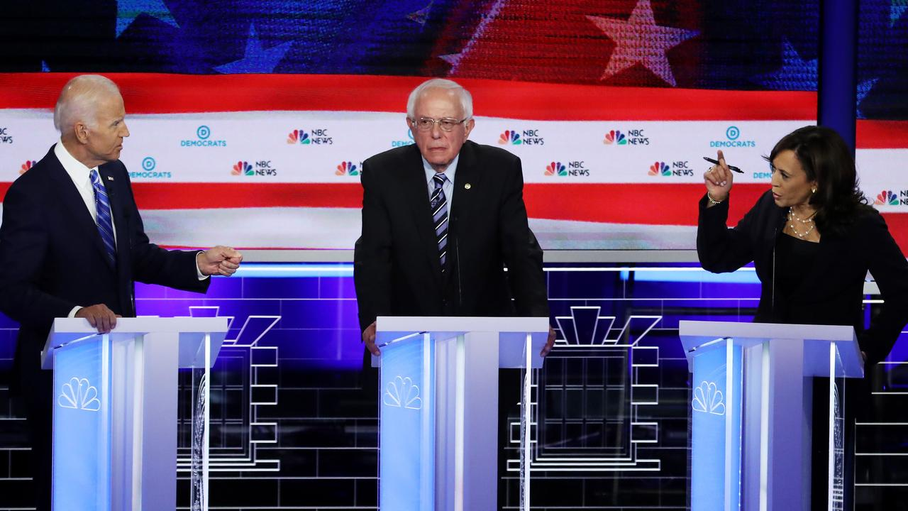 Meanwhile, old mate Bernie Sanders stood awkwardly in the middle. Picture: Drew Angerer/Getty Images/AFP