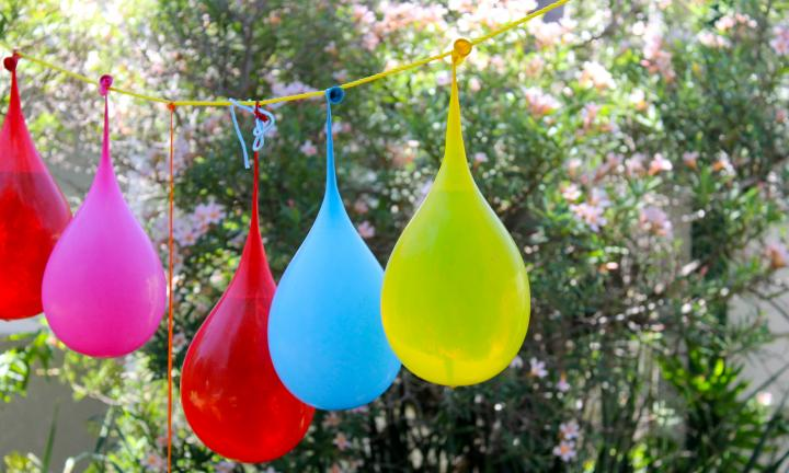 <b>WATER BALLOON PINATA</b><p>Okay, not so much an old fashioned game as a fusion of two great old games to make an even greater new game. </p><p> If your kids have never played with water balloons, they have not lived. If you want to step things up a notch, set up a water balloon piñata in your backyard. </p><p>You can use standard balloons or specialty water balloons, it doesn't matter. </p><p>Tie a rope across the backyard. You could also use the clothesline. </p><p>Fill up about eight to 10 balloons with water. Use a washing basket to hold the filled balloons while you set up. </p><p>Tie the filled balloons to the rope. </p><p>Players then take turns whacking the balloons with a stick to burst all the balloons. </p><p>Wet, messy and fun. </p><p>Make sure an adult is supervising to ensure everyone stands clear when the 'whacking' part takes place. </p>
