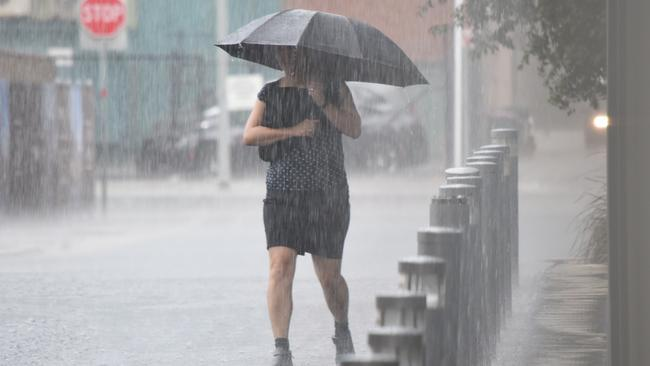 This woman was caught in Monday's autumn storm in Adelaide. You may need your brolly again today. Picture: Bernard Humphreys