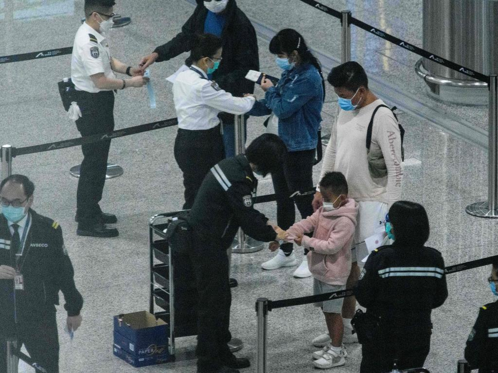 Getting through an airport is likely to be a much longer process. Picture: ANTHONY WALLACE / AFP.