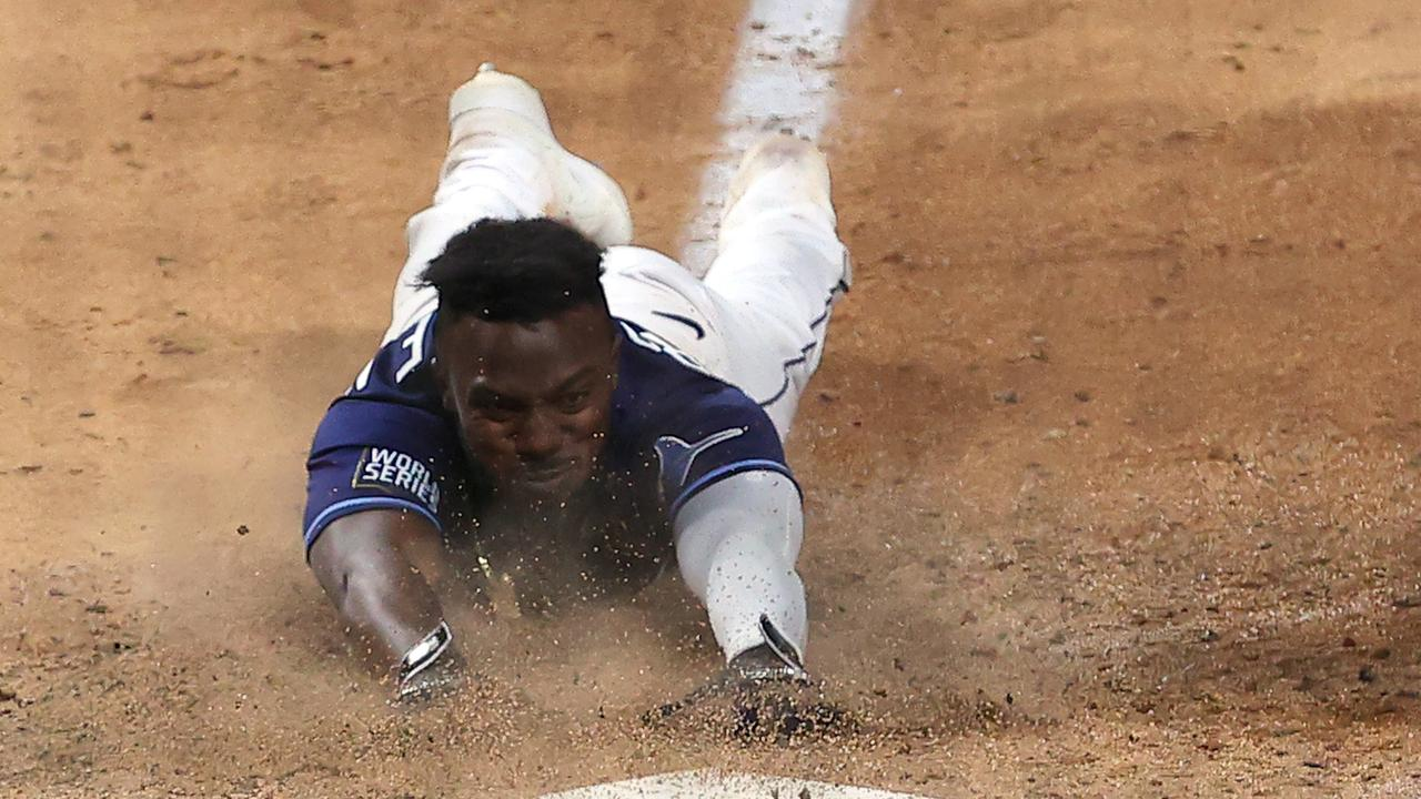 Randy Arozarena slides into home plate during the ninth inning to score the game winning run. (Photo by Tom Pennington/Getty Images)