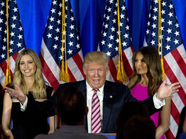 What will his family make of this? Donald Trump on stage with his wife Melania, right, and daughter Ivanka. Picture: Mary Altaffer.