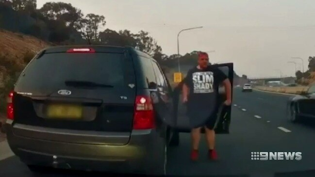 Driver filmed screaming and waving item in bizarre suspected road rage incident (9 News)