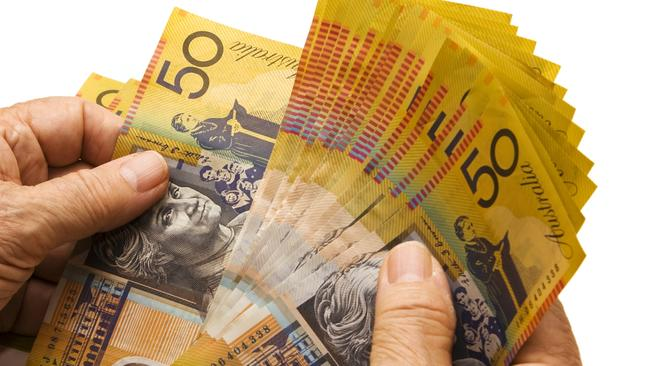 Counting the cash: a car website started by a 21-year-old Brisbane man has sold for $35 million.