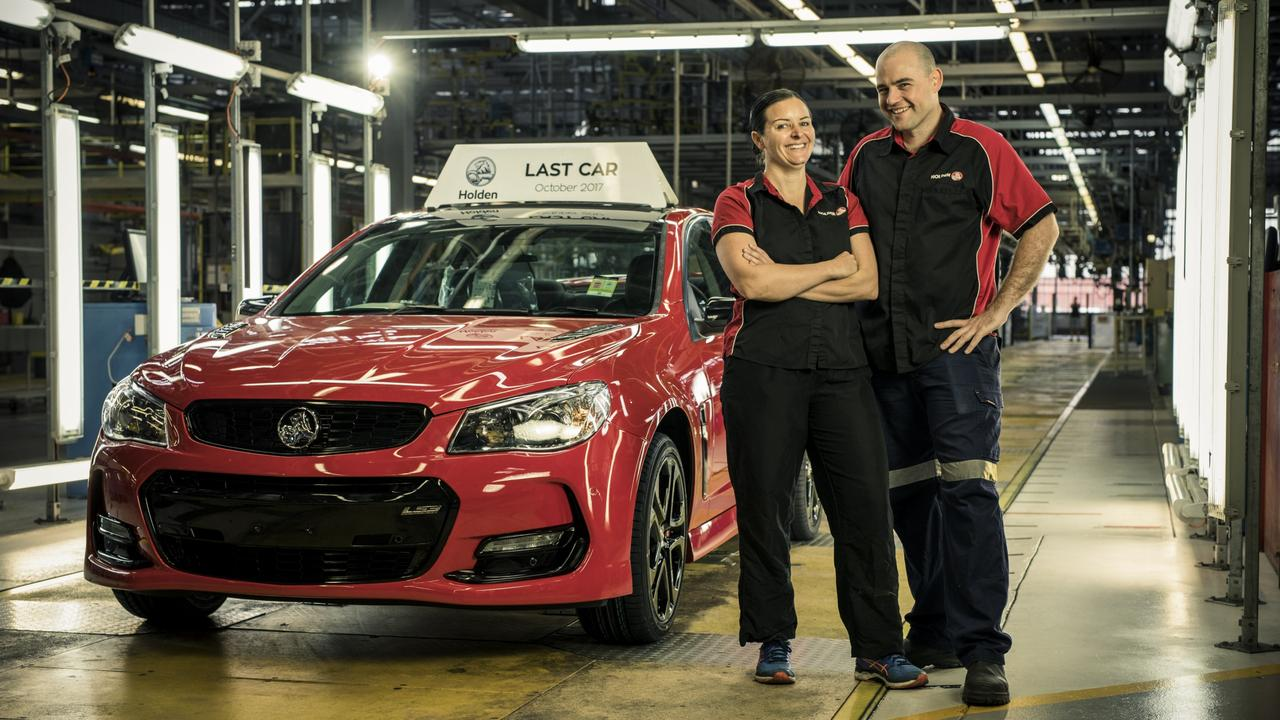 The final 2017 VF Commodore sedan coming down the final line at the Holden Elizabeth factory. Pictured are employees Lisa Hutchinson and Andrew Wyett. Credit: Randy Larcombe