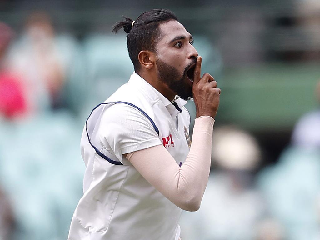 Mohammed Siraj celebrates his wicket of Australia's David Warner.