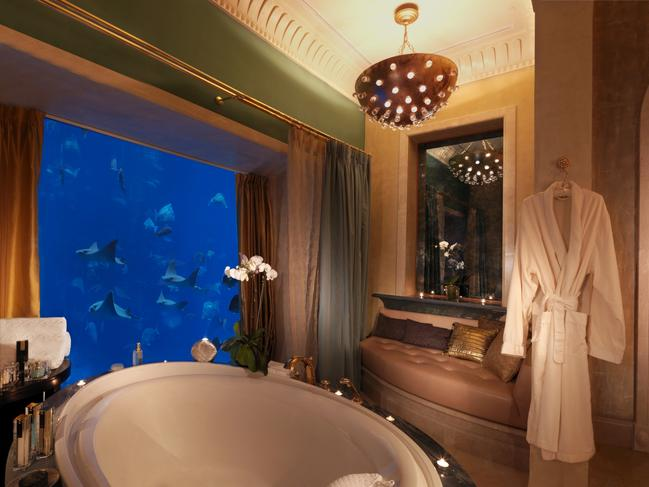 "UNDERWATER SUITES, ATLANTIS THE PALM, DUBAI: With an insatiable appetite for ""wow"" factor; it's unsurprising that Dubai lays claim to not one, but two underwater hotel suites, both of which boast 24-carat gold bathroom fixtures and fittings. On the tip of the man-made Palm Jumeirah, Atlantis' stunning three-storey aquatic themed suites (accessed by private lift) come with floor-to-ceiling windows that take in the 65,000 marine inhabitants — including stingrays and sharks — that occupy a three-million-gallon aquarium. If that's not enough to bring a smile to your lips, a personal butler will be at your beck and call 24/7 to cater to your every whim. atlantisthepalm.com"