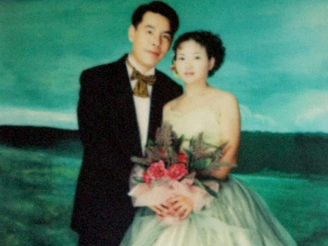 A wedding picture of Min Lin and Yun Li (Lilly) hangs on the wall inside the entrance to the Lin family home in Epping, Sydney.