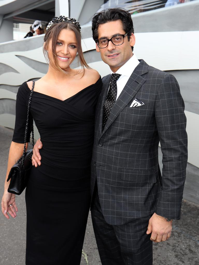 Jon Adgemis with Cheyenne Tozzi in the birdcage on Melbourne Cup day Picture: David Geraghty / The Australian.