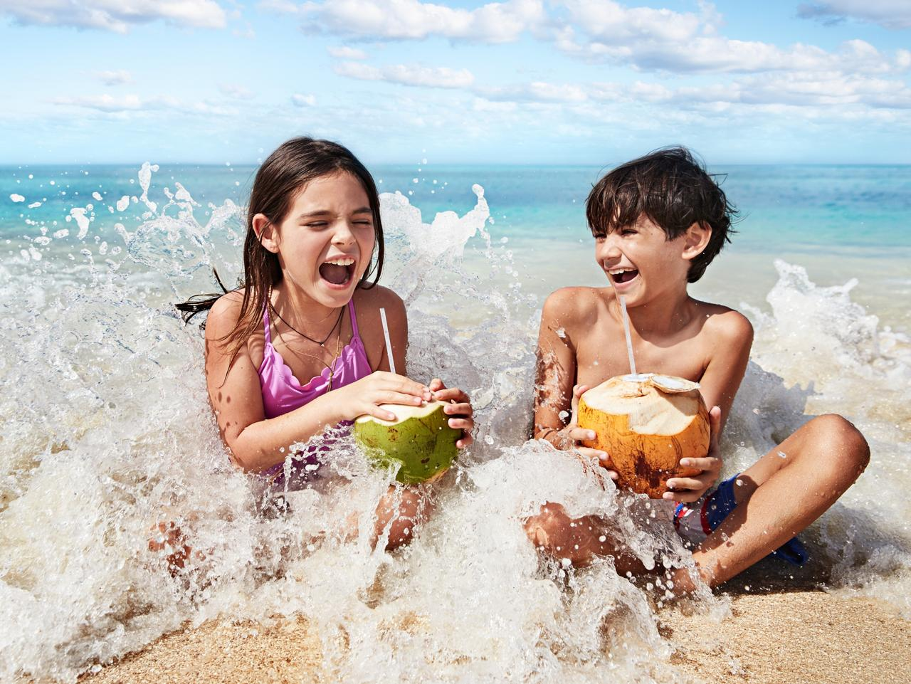 ESCAPE:  Kids Playing In The Surf, Antigua, Caribbean Princess. Picture: Supplied/Princess