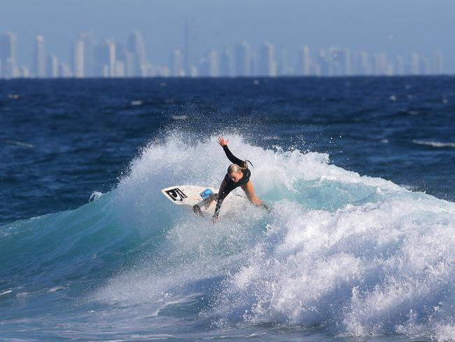 Large swells on the Gold Coast have closed seven beaches. Picture: NIGEL HALLETT