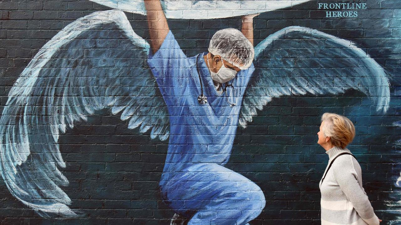 A mural of a nurse in Melbourne shows them as heroes, on International Nurses Day in Melbourne on May 12, 2020. Picture: William West / AFP