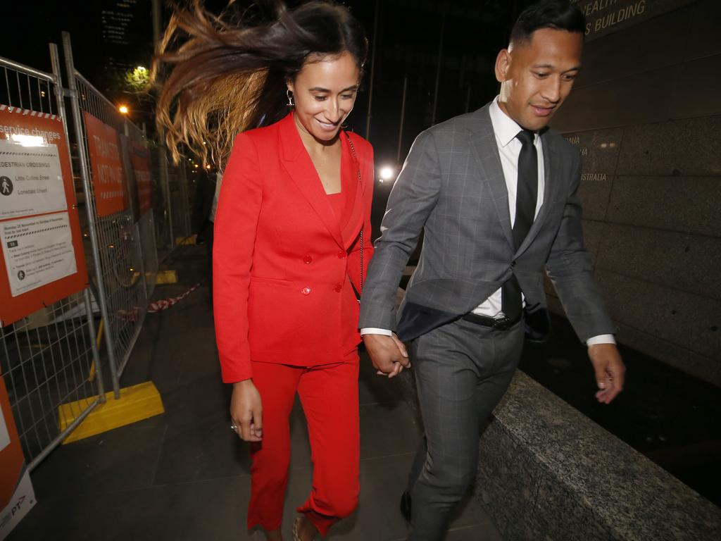 Maria Folau holds hands with husband Israel as he leaves Federal Court on December 02, 2019 in Melbourne, Australia. Folau met with Rugby Australia to begin mediation talks surrounding his dismissal from his Rugby Australia contract for player code breaches. Picture: Darrian Traynor