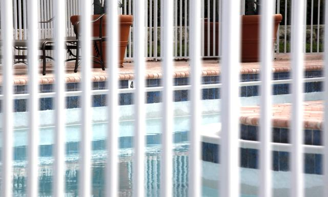 the fence around a swimming pool