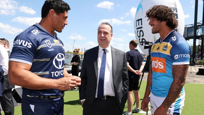 """ARL Chairman Peter V'landys, pictured talking to Jason Taumalolo of the Cowboys and Kevin Proctor of the Titans, said the NRL had """"no choice"""" but to relocate to Queensland amid Sydney's COVID-19 outbreak. Photo by Cameron Spencer/Getty Images"""
