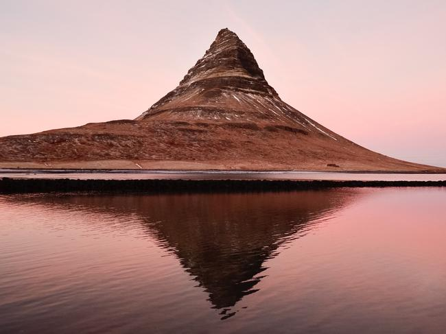 "KIRKJUFELL, ICELAND ""We were looking for the best sunset, and we eventually found it at Kirkjufell, the iconic Icelandic mountain. I didn't have my tripod, and I couldn't get a long exposure. I was trying to find the best angle for that reflex to get the shot right!"" – @samuelemiccoli"