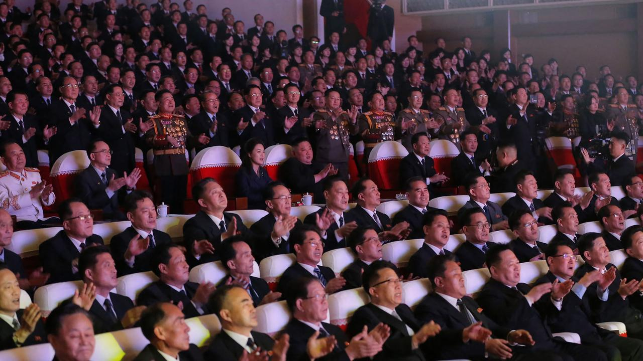 No one was wearing masks at the event that commemorated Kim Jong-un's father and predecessor. Picture: STR/AFP