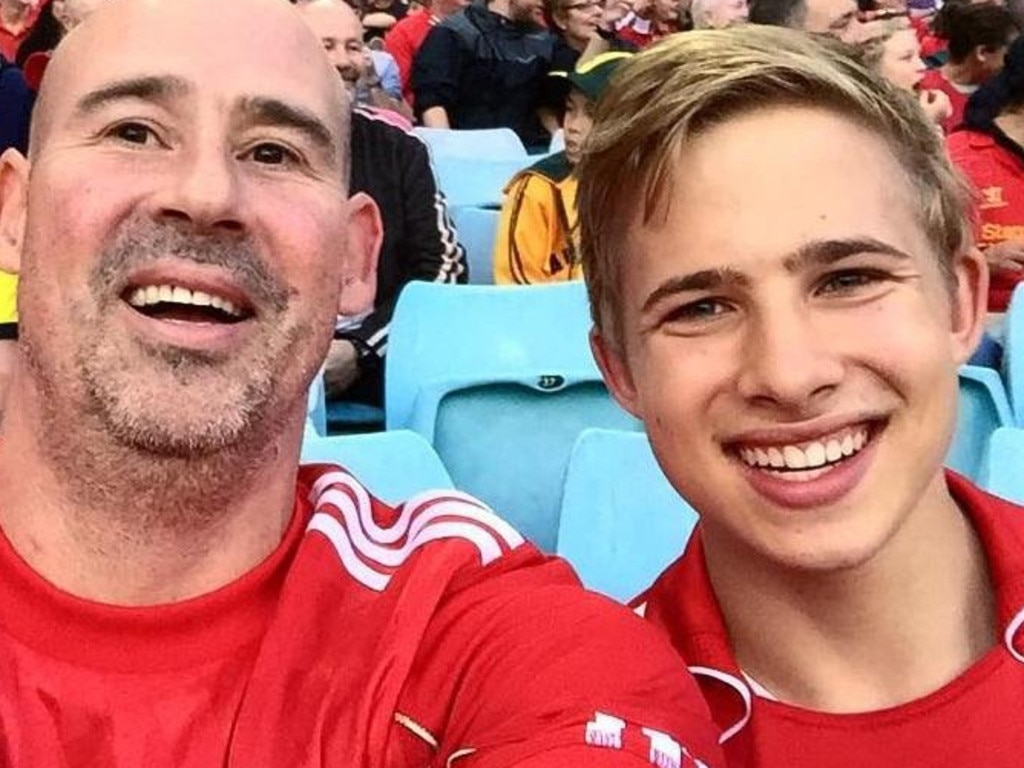 Kyle Daniels with his father James at a football game in happier times. Picture: Supplied
