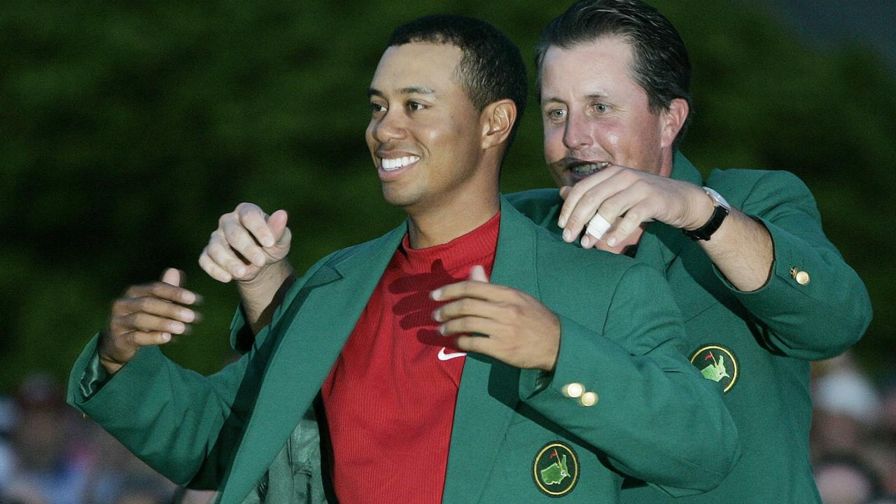 Tiger Woods, left, gets the Green Jacket from Phil Mickelson, right, after winning the 2005 Masters at the Augusta National Golf Club. Picture: AP Photo