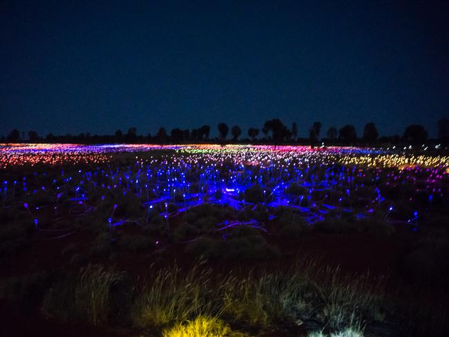 """EXPLORE THE 'FIELD OF LIGHT' ART INSTALLATION British artist Bruce Munro's Field of Light art installation uses over 50,000 coloured solar-powered light spheres to illuminate the desert with a fantasy garden of light spindles. This acclaimed light installation, opened until the end of 2020, is a gentle rhythm of colour, and is known as Tili Wiru Tjuta Nyakutjaku or """"looking at lots of beautiful lights""""."""