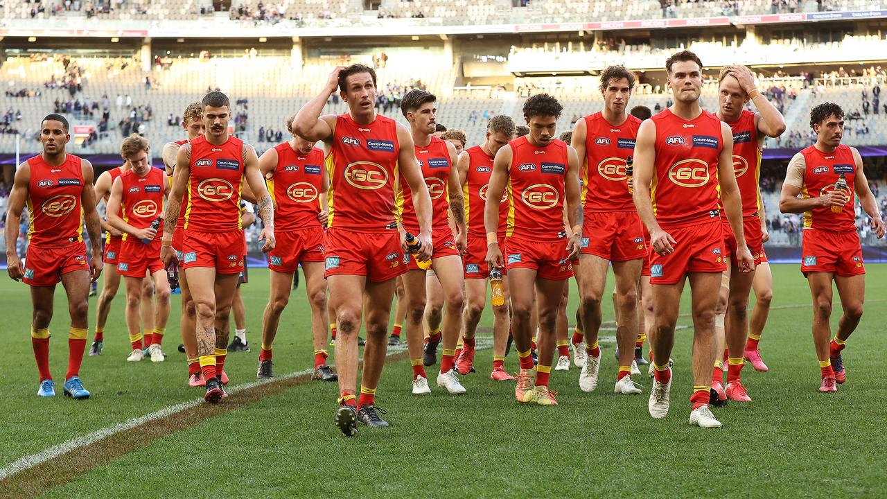 The Suns walk from the field after being defeated by the Fremantle Dockers. Picture: Paul Kane