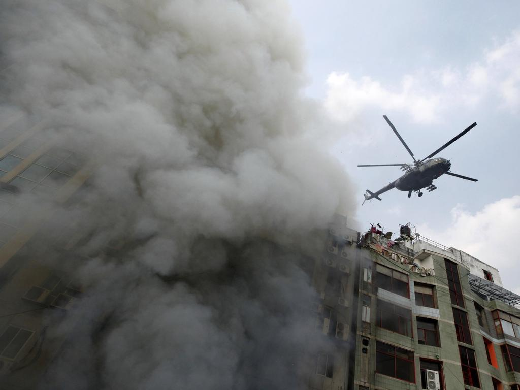 A chopper hovers to evacuate people stuck in a multi-storied office building that caught fire in Dhaka, Bangladesh, Thursday, March 28, 2019. Picture: AP