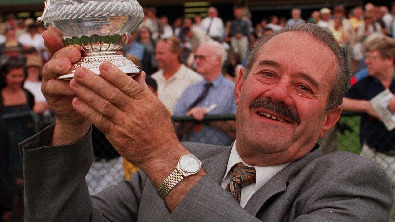 Mornington Cup. Winning trainer of 'Dancing Sculptor' Jim Marconi holds aloft the cup. p/. 17 February 1999. /racing       /trophies