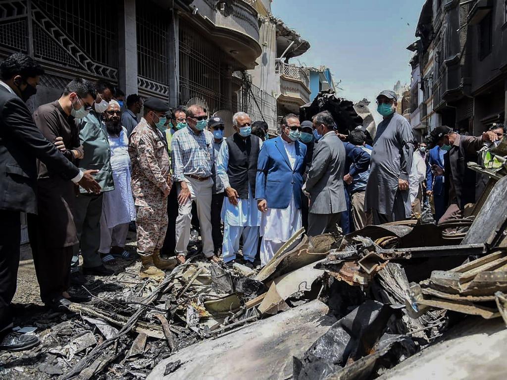 Pakistan authorities inspect the crash site of Pakistan International Airlines flight 8303 in a residential neighbourhood in Karachi. Picture: Pakistan Civil Aviation Authority/AFP