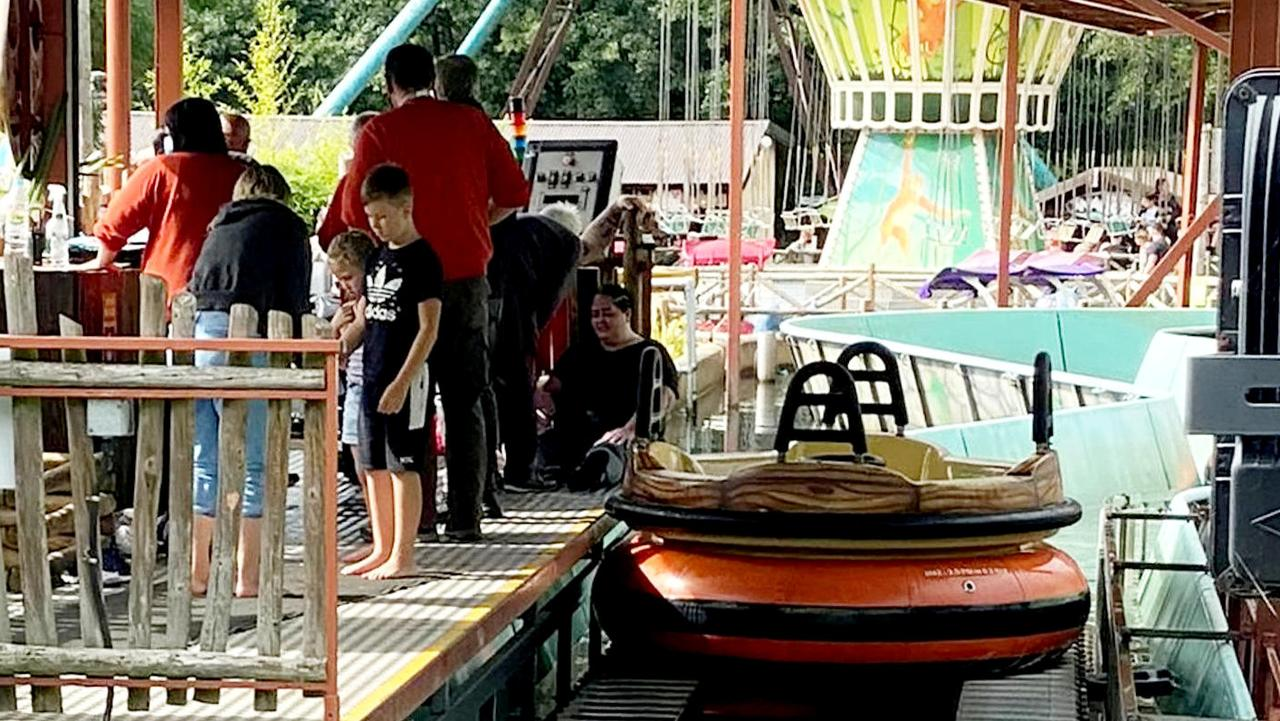 A family of four were rescued from the water after their boat capsized on a river rapid ride at a popular theme park.