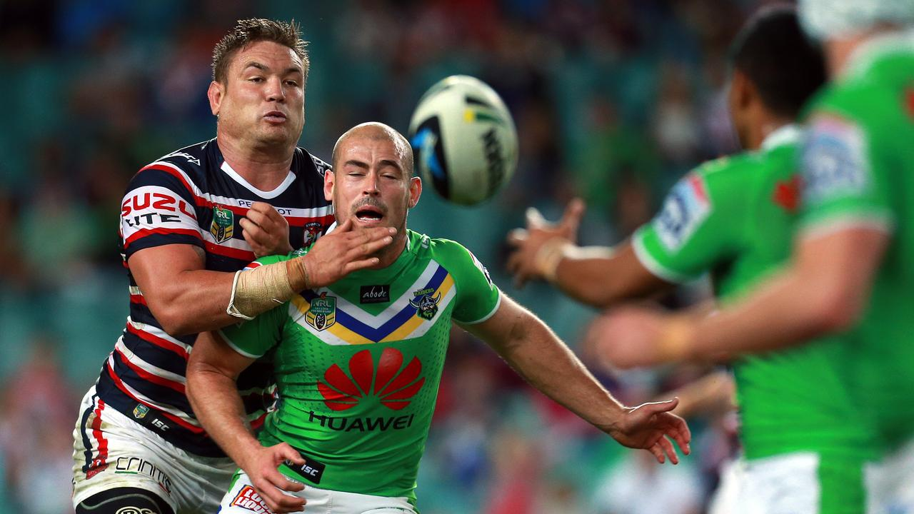 Sydney City Roosters host Canberra Raiders at Allianz Stadium in round 12 of the 2014 NRL season. Terry Campese tackled by Jarred Waerea-Hargreaves.