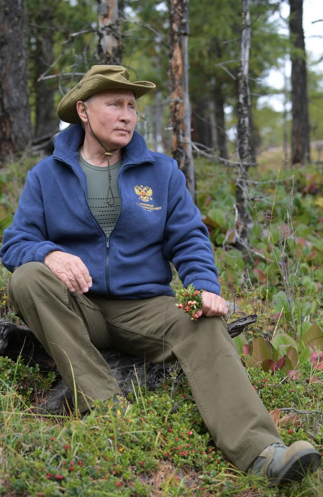 In this undated photo released by Russian Presidential Press Service, Russian President Vladimir Putin holds a bunch of wildflowers on his birthday hike. Picture: AP