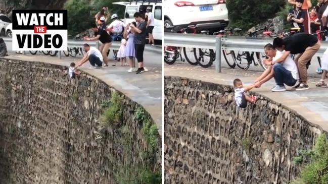 Father dangles son over cliff edge