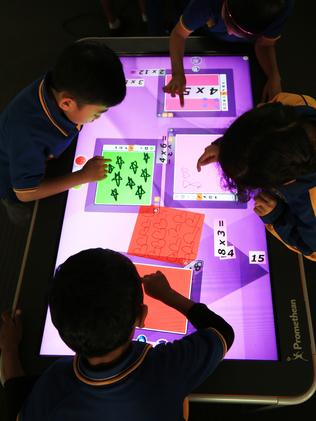 Focussed ... Students learn activities on the Promethian Active Smart Table in an area called The Hub. Picture: Toby Zerna