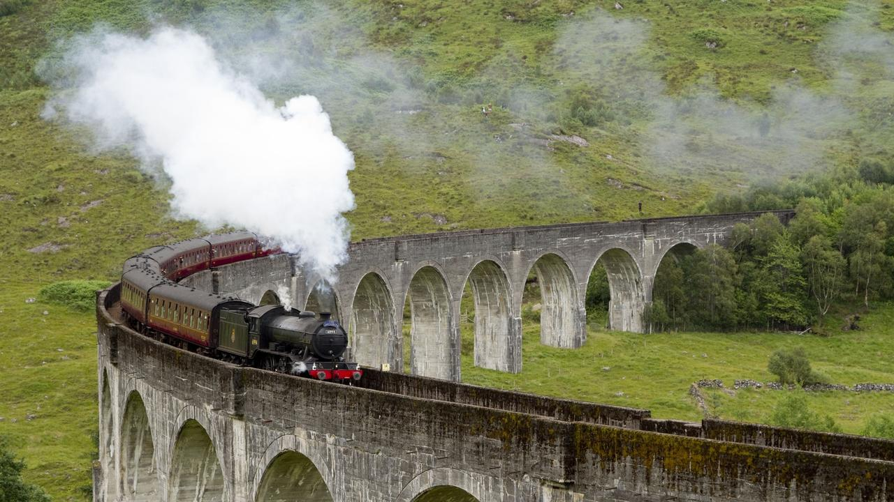 The Jacobite steam train passing over the Glenfinnan Viaduct at the head of Loch Shiel.