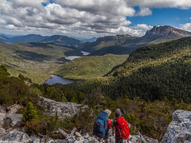 10. FRENCHMANS CAP, TAS LENGTH: 50KM/5 DAYS, DIFFICULTY: 9/10 - Carved during the Pleistocene glaciation, Frenchman's Cap bursts from World Heritage wilderness like a ship's prow with a 450m vertical face of quartzite rising to 1446m. The walk is classic alpine Tassie, with buttongrass plains, dense rainforest and glacial lakes. It's a scramble to reach the Cap's summit, but the reward is 360-degree views. This one is remote and challenging with changeable alpine weather, and even on a guided tour you'll need to carry equipment and food.