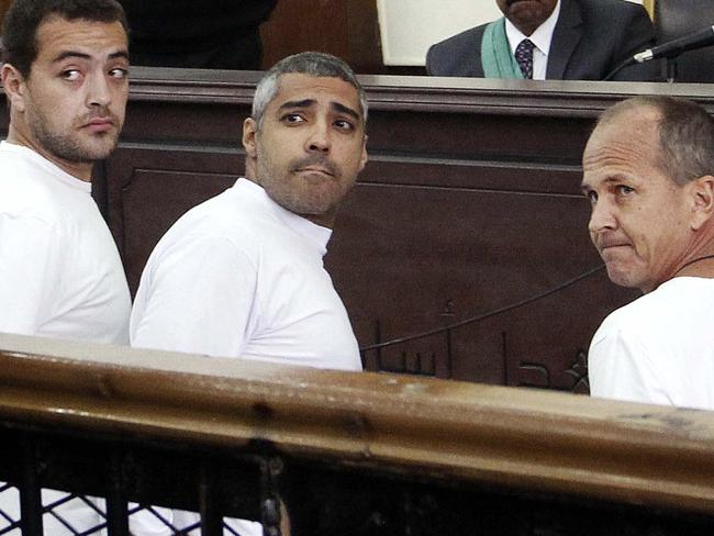 On trial ... Al-Jazeera English producer Baher Mohamed (left, Canadian-Egyptian acting Cairo bureau chief Mohammed Fahmy and correspondent Peter Greste appear in an Egyptian court on terror charges. Picture: AP Photo/Heba Elkholy, El Shorouk