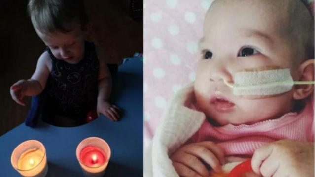 Charlie with the two candles lit in honour of Cailee and Caitlyn. Picture: Facebook.
