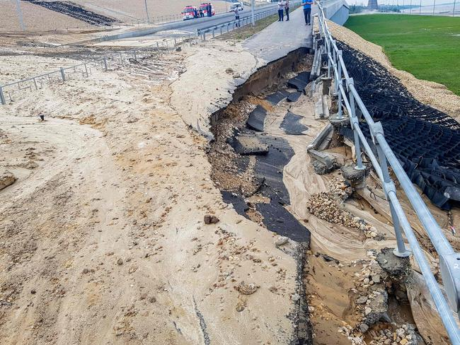 A road was washed away by a heavy rain in Volgograd. Picture: AFP PHOTO / ILIA VARLAMOV