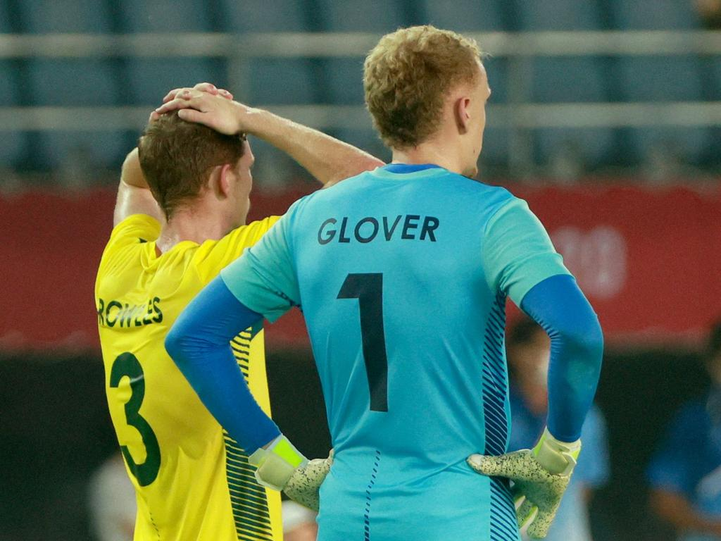 Australia's defender Kye Rowles and Australia's goalkeeper Thomas Glover react after the end of their campaign.