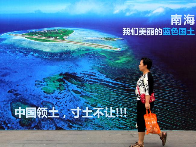 A billboard in east China's Shandong province reads: 'South China Sea, our beautiful motherland, we won't let go an inch'. Picture: Chinatopix