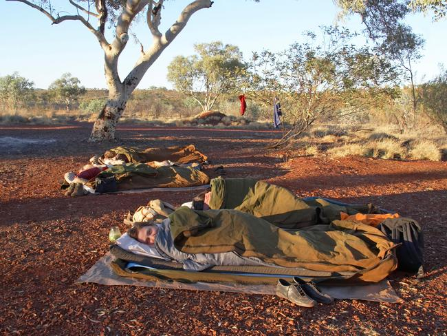 62. SLEEP IN A SWAG IN THE AUSTRALIAN OUTBACK Channel your best Banjo Paterson and head bush. There's nothing more Australian than camping out under the stars in a swag - red earth below, southern cross above. Canine companion optional. Picture: Alamy