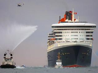 The Queen Mary 2 (QM2) arrives at Port Everglades in Florida on her maiden voyage 26 Jan 2004, as tug boats shoot water cannons to celebrate her arrival. AFP picRobert/Sullivan cruise liner ship ships shipping