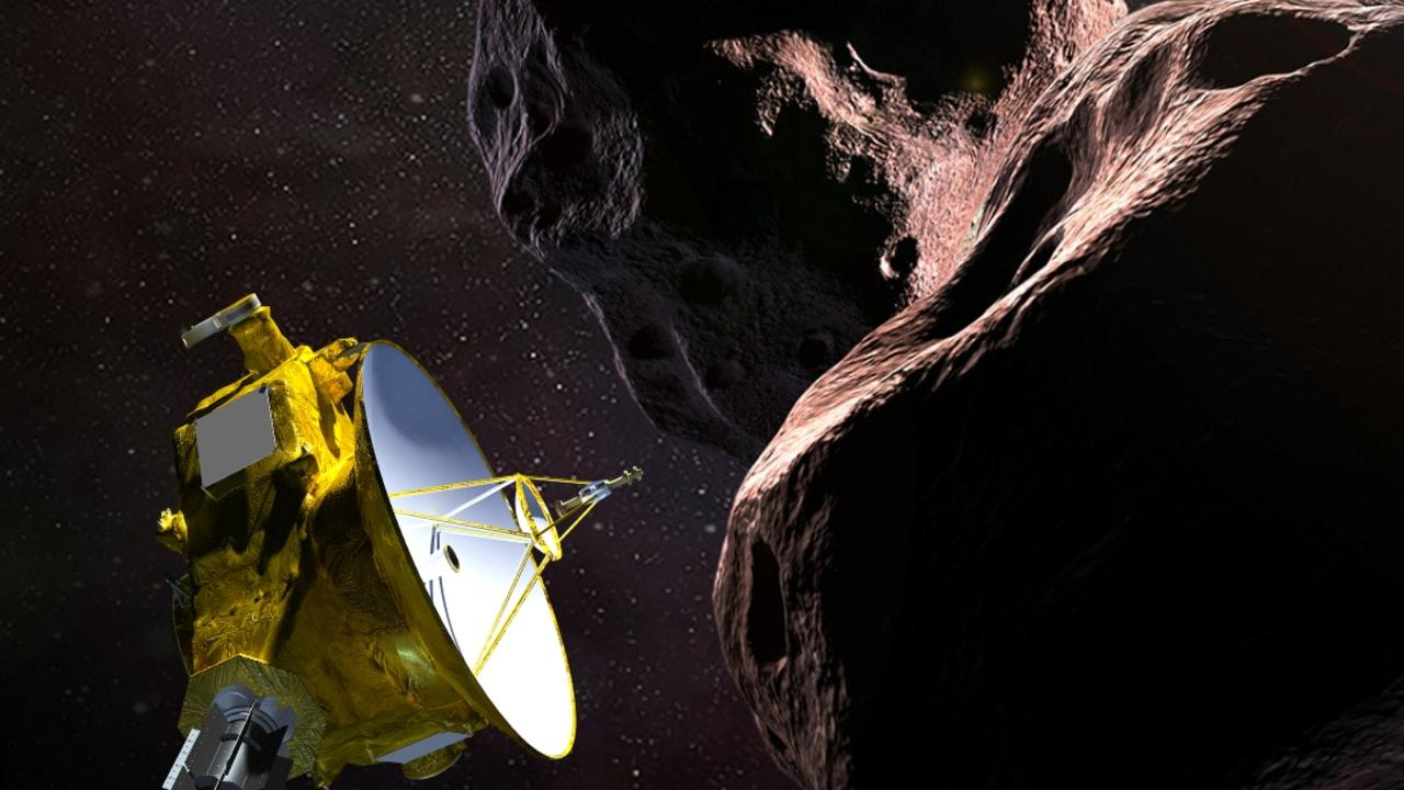 "An artist's illustration obtained from NASA showing the New Horizons spacecraft encountering the space ""snowman. Picture: HO / NASA/JHUAPL/SwRI / AFP)"
