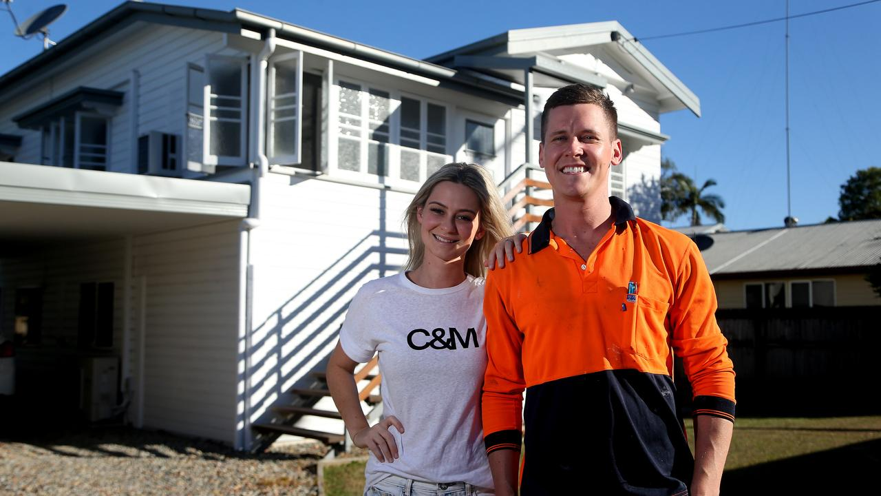 Tess and Luke outside the Manunda home as they put it up for sale. Picture: STEWART MCLEAN