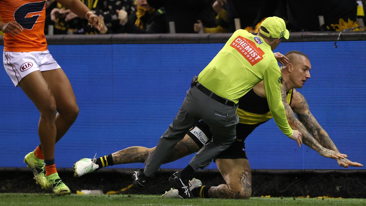 The goal umpire couldn't finish the game. Photo: Michael Klein