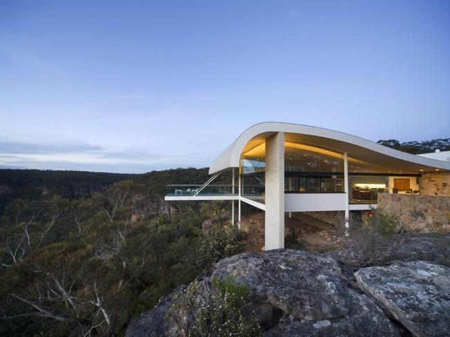 THE HARRY SEIDLER HOUSE, SOUTHERN HIGHLANDS, NSW: Set among 150-acres of natural bush and built into a natural, rugged sandstone escarpment, The Harry Seidler House in NSW's Southern Highlands is an architectural gem. Completed in 2000 by the late master architect, his signature use of concrete and curves can be seen in the building.