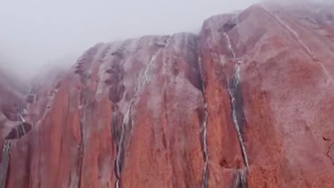 A screen shot taken from a video showing rare rainfall at Uluru. February 2021. Picture: Facebook/Uluṟu-Kata Tjuṯa National Park