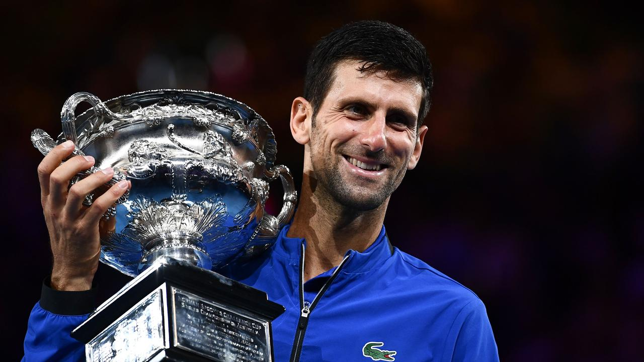 Serbia's Novak Djokovic shows off the championship trophy after winning the Australian Open men's final for a record seventh time. Picture: AFP