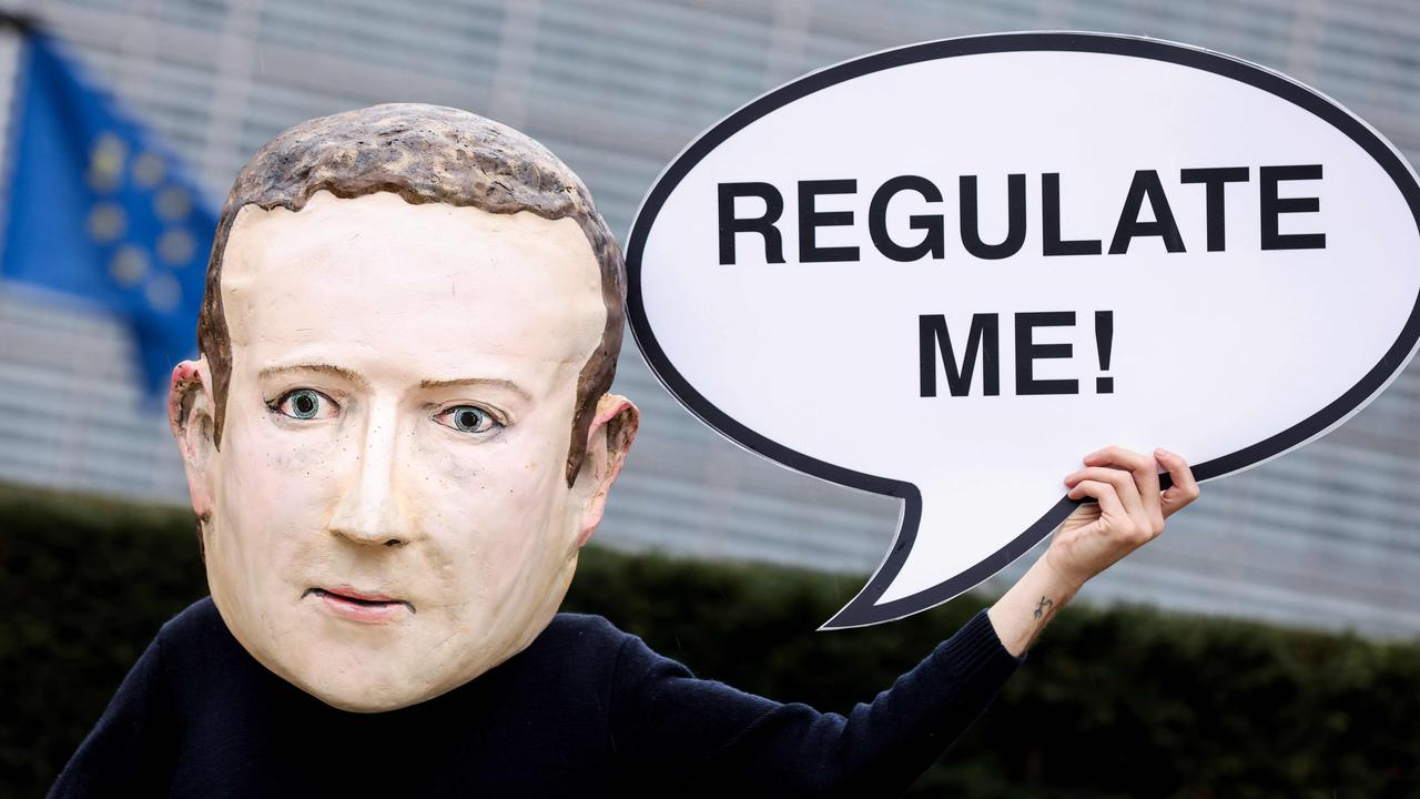 An activist protesting Facebook outside the European Commission building in Brussels. Picture: Kenzo TRIBOUILLARD / AFP